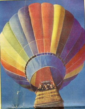 Primary view of object titled '[Arlington Police Chaplain Harold Elliott marrying two police officers in a hot air balloon]'.