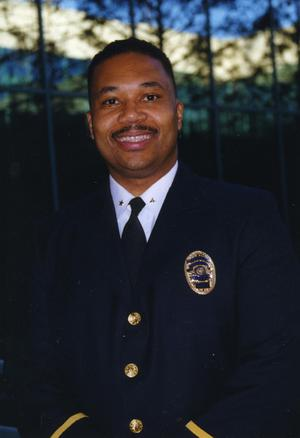 Primary view of object titled '[Arlington Police Assistant Chief Michael Ikner, portrait 2002]'.