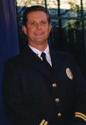 Primary view of object titled '[Arlington Police Assistant Chief Tommy Ingram, portrait 2002]'.