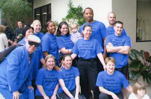 Primary view of object titled '[Arlington Police Chaplain Harold Elliott with group of Polar Plunge supporters, 2006]'.