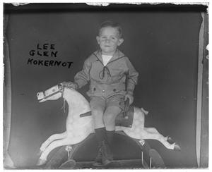 [Portrait of Boy on Rocking Horse]