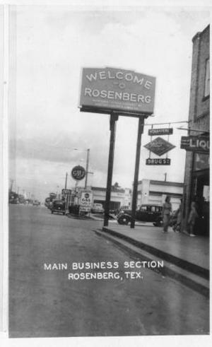 "Primary view of object titled '[""Welcome to Rosenberg"" sign in downtown Rosenberg, TX]'."