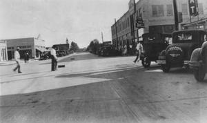 Primary view of object titled '[Busy Main Street in downtown Rosenberg]'.