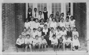 Primary view of object titled '[Rosenberg Public School students in front of closed doors]'.