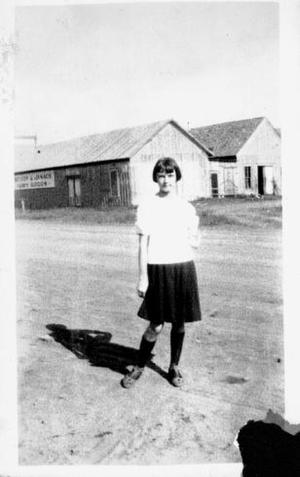 Primary view of object titled '[Young girl downtown Rosenberg, TX]'.
