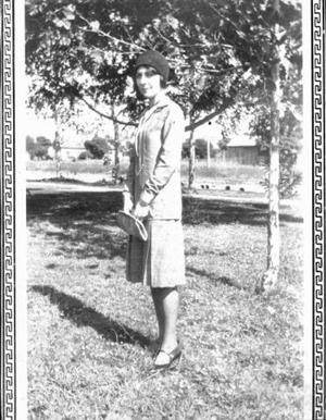 Primary view of object titled '[Emma Phillippi Miller, Rosenberg resident, standing in front of trees]'.