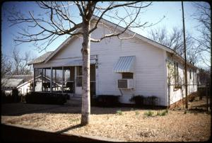 Primary view of object titled '[Cottage in New Town Neighborhood, Marshall, Texas]'.