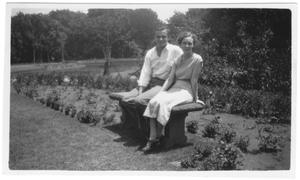 Primary view of object titled '[Bob McGlamery and Mlidred Phillips sitting on a bench at Weatherford College]'.