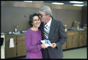 Primary view of object titled '[David Holt and Kathy Alexander Exchange a Present]'.