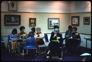 Primary view of object titled '[People Attend a Meeting]'.