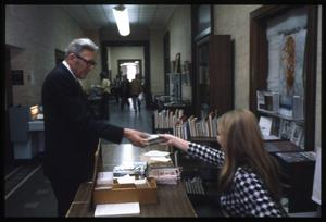 [Man and Woman Exchange a Book]