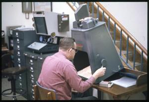 [Man Uses a Microform Machine at Austin Public Library]