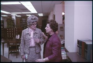 Primary view of object titled '[Two Women in a Discussion in a Library]'.