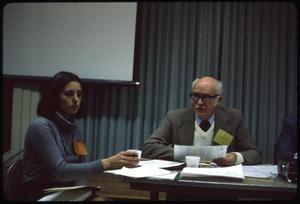 Primary view of object titled '[Biruta Kearl and Sam Whitten at a Meeting]'.