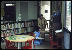 Primary view of object titled '[Women Browse Children's Section #2]'.