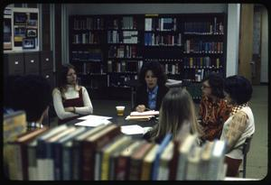 Primary view of object titled '[Group Meeting in a Library]'.