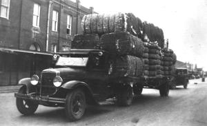Primary view of object titled '[Truck loaded with cotton bales]'.