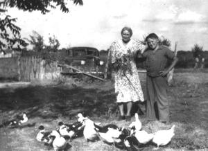 Primary view of object titled '[Molly Asher and Weber McNeese with ducks]'.