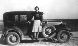 [Frances McNeese Archer standing with car]