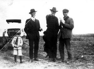Primary view of object titled '[Three men and boy in front of buggy]'.
