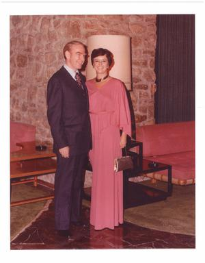 Primary view of object titled '[Jim Wright with a woman in a pink dress]'.