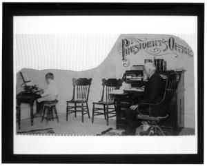Primary view of object titled '[Dr. David Switzer in the President's Office]'.