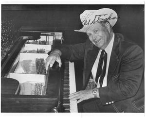 Primary view of object titled '[Autographed photo of Al Stricklin at the piano]'.