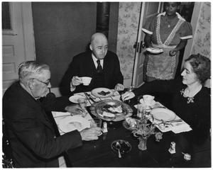 Primary view of object titled 'Photograph of Sam Rayburn Eating Breakfast'.