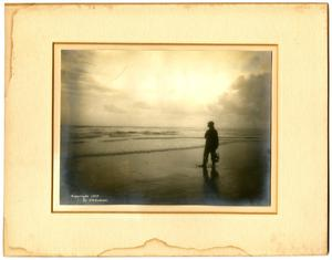 Primary view of Photograph of man on beach
