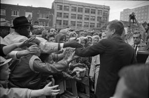 Primary view of object titled '[President Kennedy greeting crowd outside of Hotel Texas]'.