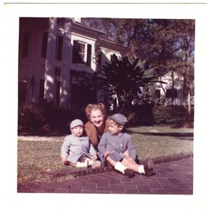 [Lillie Abercrombie with two toddlers on lawn]