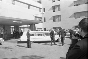 Primary view of object titled '[Hearse backing into the emergency entrance bay at Parkland Hospital]'.