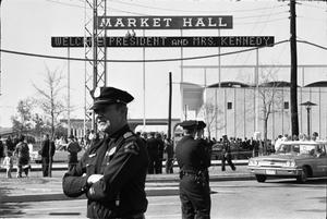 [Dallas Police officers standing guard outside the Dallas Trade Mart]