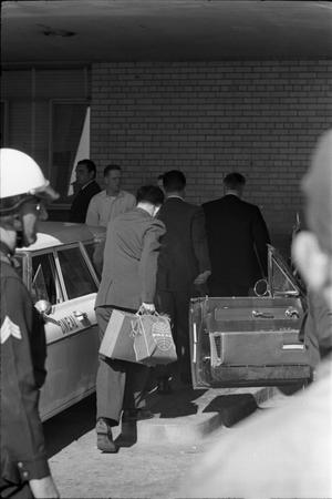 Primary view of object titled '[Assistant Press Secretary Malcolm Kilduff entering Parkland Hospital]'.