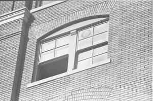 [A fifth floor window of the Texas School Book Depository]