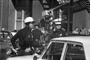 [Dallas Police officers in the intersection of Elm and Houston streets]