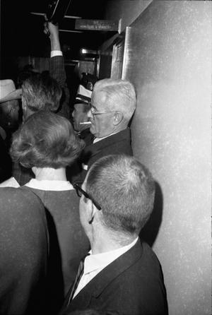 Primary view of object titled '[Crowded hallway at Dallas Police Headquarters]'.
