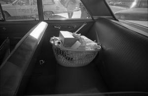Primary view of object titled '[Basket full of items in a car parked at Parkland Hospital]'.