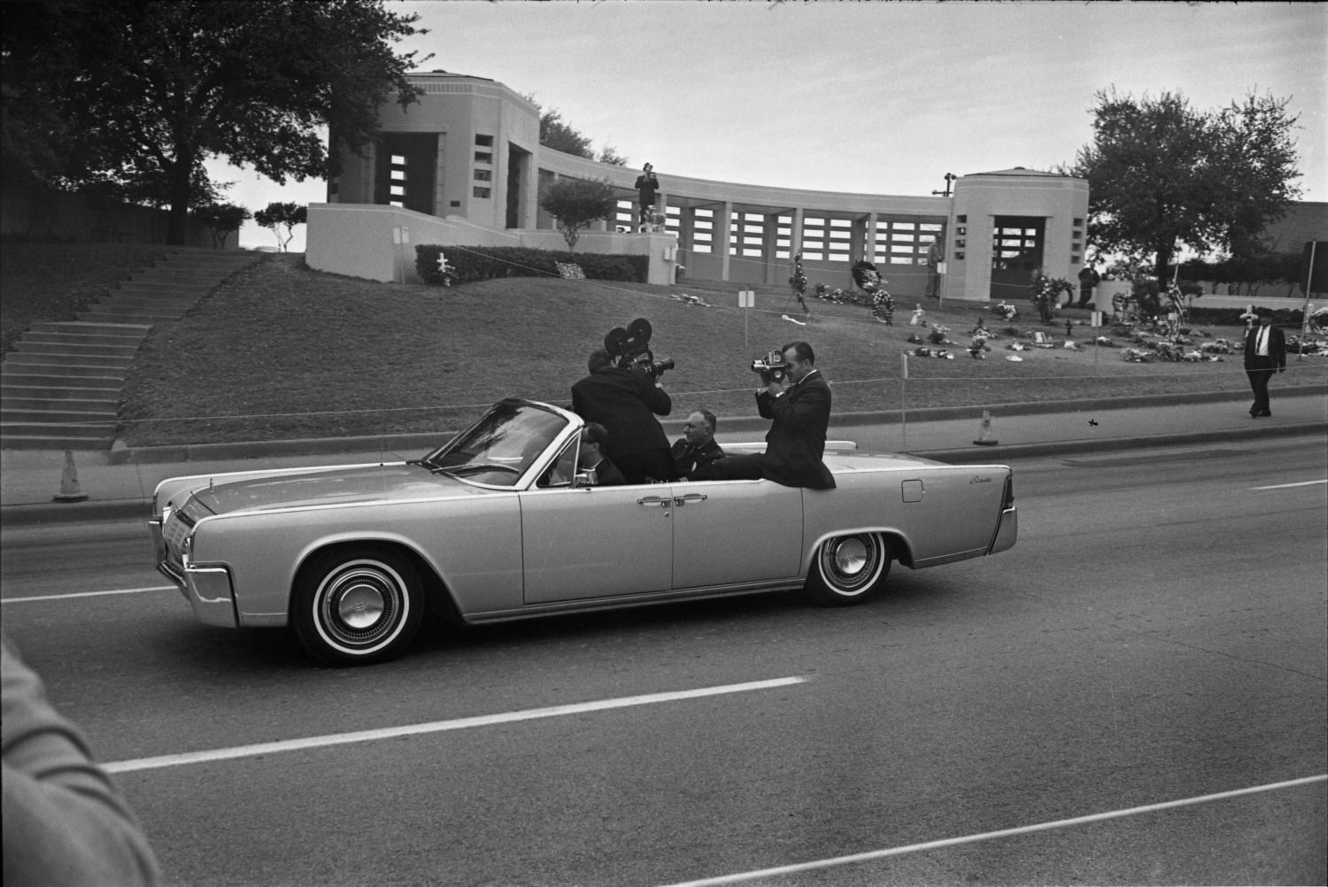 Convertible With Secret Service Agents Reenacting The