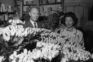 [Dallas florists with roses to be used to decorate the Dallas Trade Mart]
