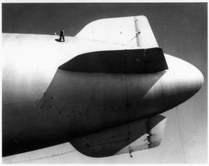 Primary view of object titled '[Replacing a fin brace and suspension patch on a K-62 blimp at Hitchcock Naval Air Station]'.