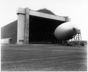 [Men holding ropes, blimp at Hitchcock Naval Air Station]