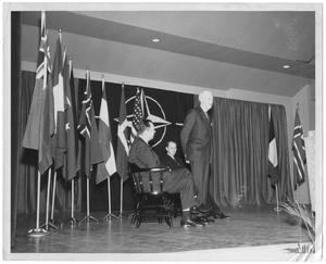 Primary view of object titled '[William Lockhart Clayton with unidentified men on stage with flags]'.