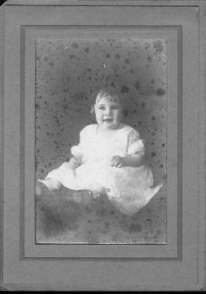 Primary view of [Mary Jones around age of one, wearing a white dress]