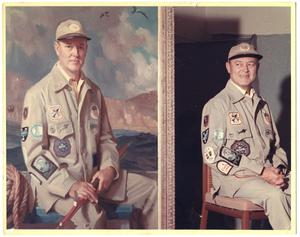 Primary view of object titled '[Alfred C. Glassell, Jr. posed in fishing attire smiling beside Robert Joy portrait]'.