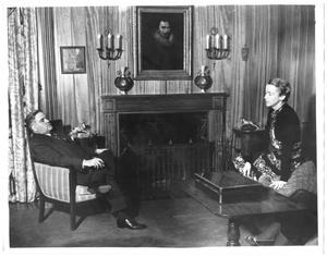 Primary view of object titled '[George A. Hill, Jr. and Mary Hill with fireplace in background]'.