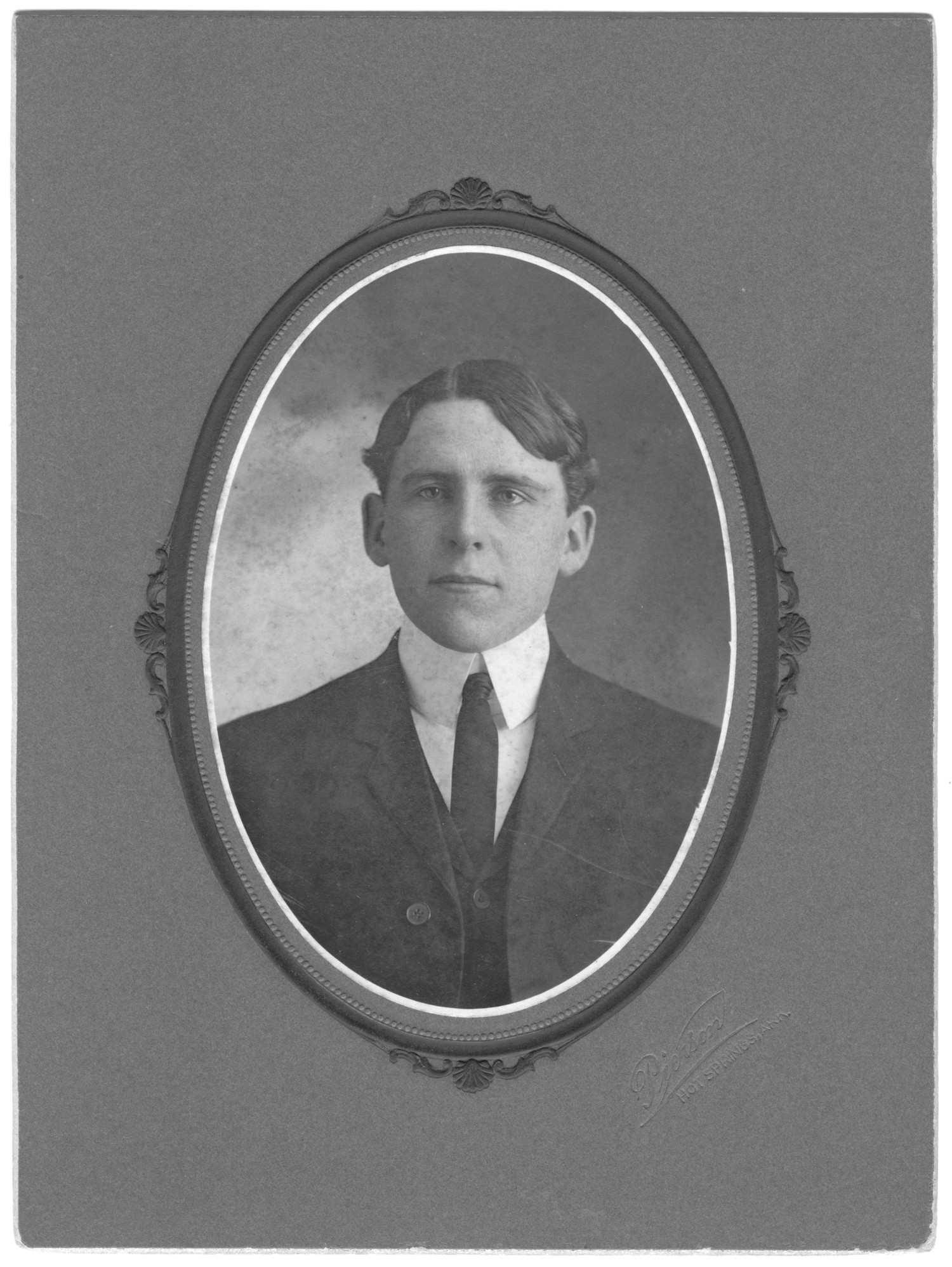 [James McKay Lykes oval portrait, black and white], Formal oval portrait of James McKay Lykes in his early 20s, wearing a suit and a tie.,