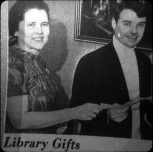 Primary view of object titled '[Donor Presents Gift to New Library]'.