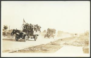 Primary view of object titled '[Army Truck Train Transporting Troops]'.