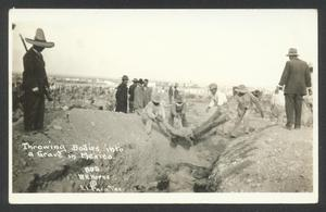 Primary view of object titled '[Throwing Bodies into a Grave in Mexico]'.